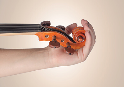 Violin in palm close up